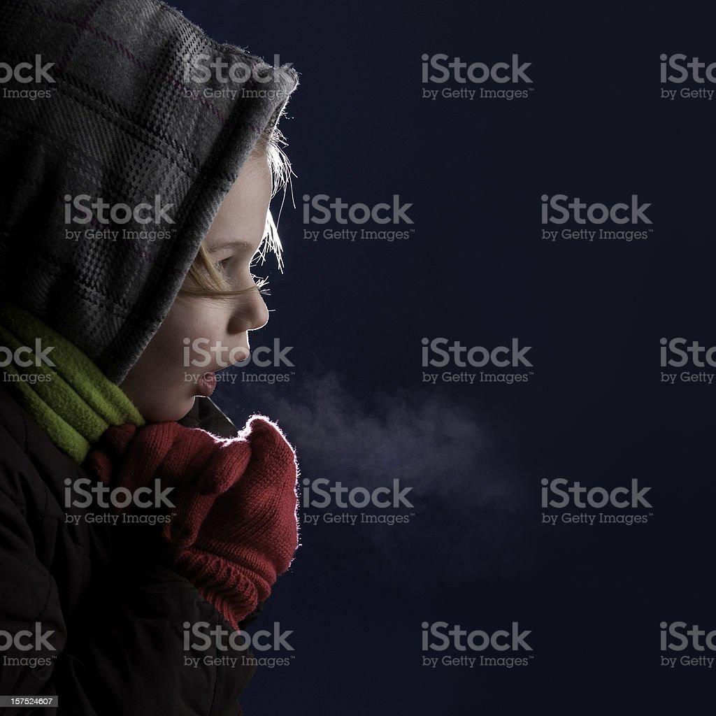 cold chilling girl in the dark stock photo