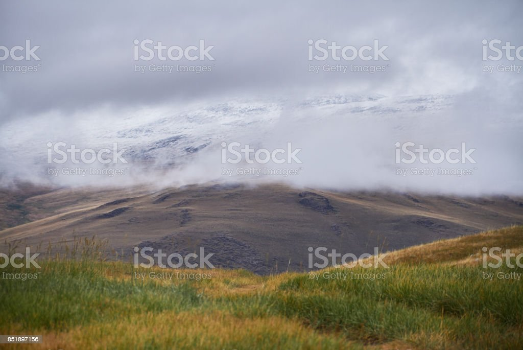 Cold cloudy weather in the steppe area. The Ukok Plateau Of Altai. Fabulous cold landscapes. Anyone around stock photo
