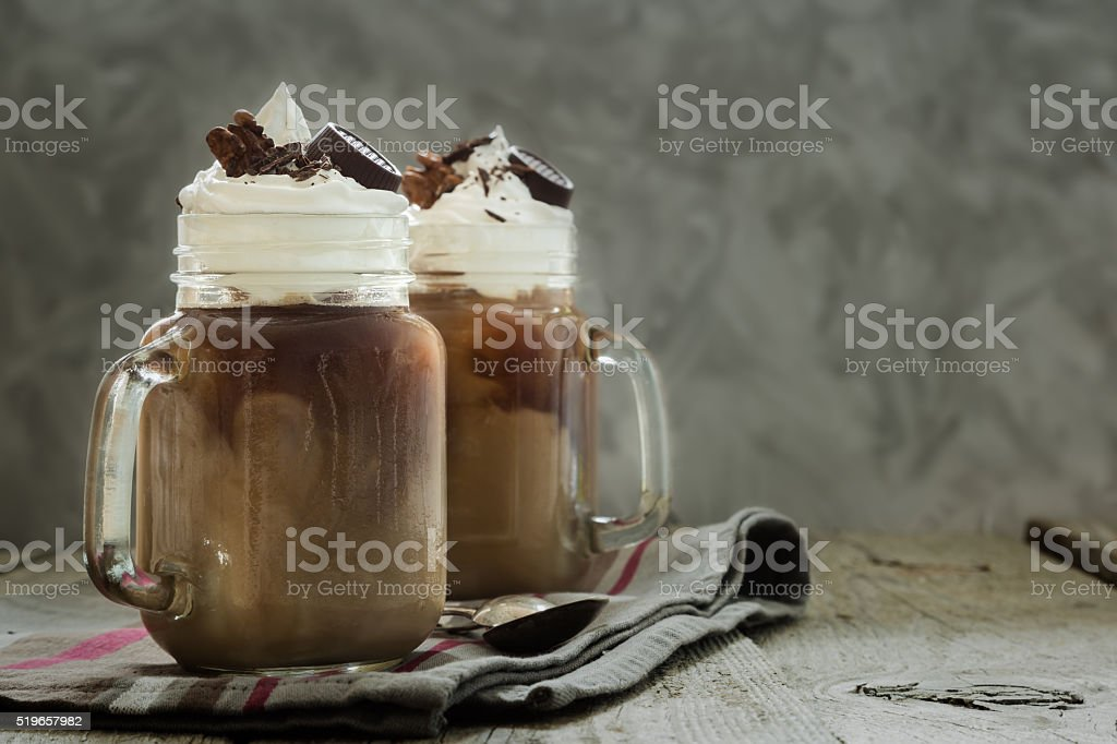 Cold coffee drink in glass jar stock photo