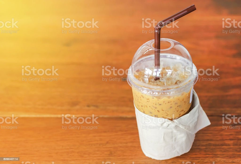 Cold coffee with straw in plastic cup stock photo