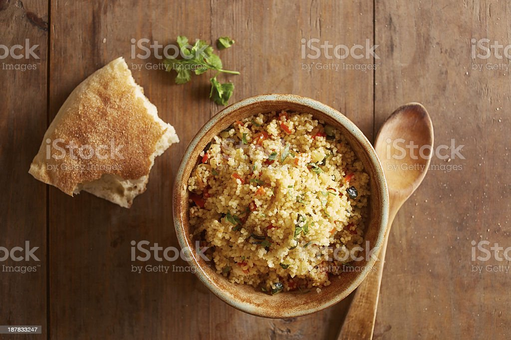 Cold couscous salad with vegetables stock photo
