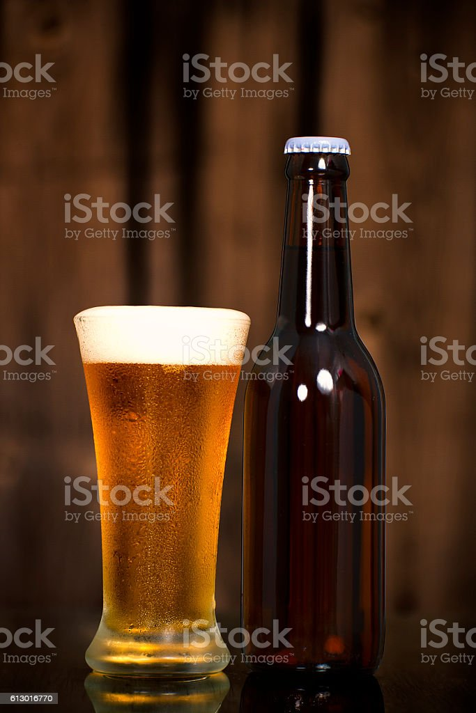 Cold Craft Beer of two bottles and a glass stock photo