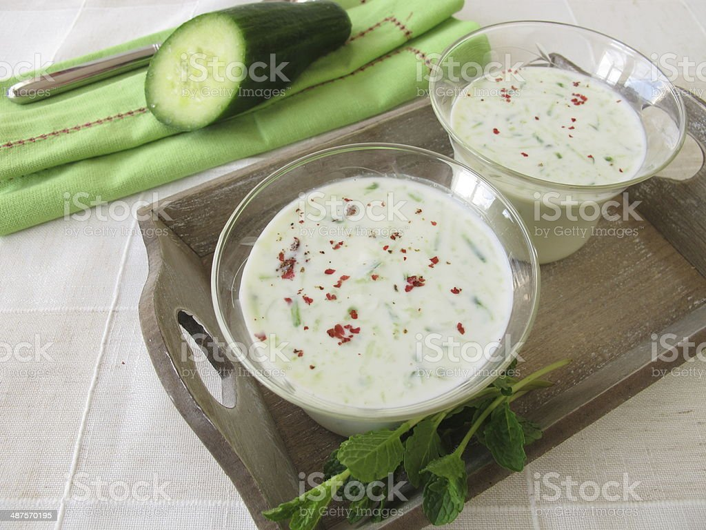 Cold cucumber soup served in glass stock photo