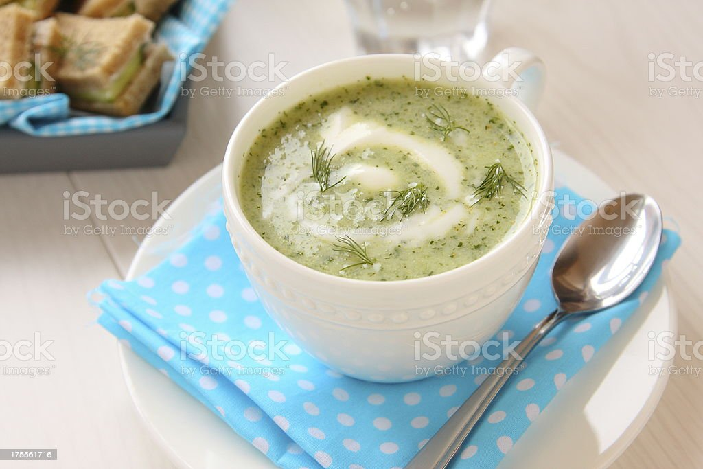 Cold cucumber soup with dill, yogurt and sandwiches royalty-free stock photo