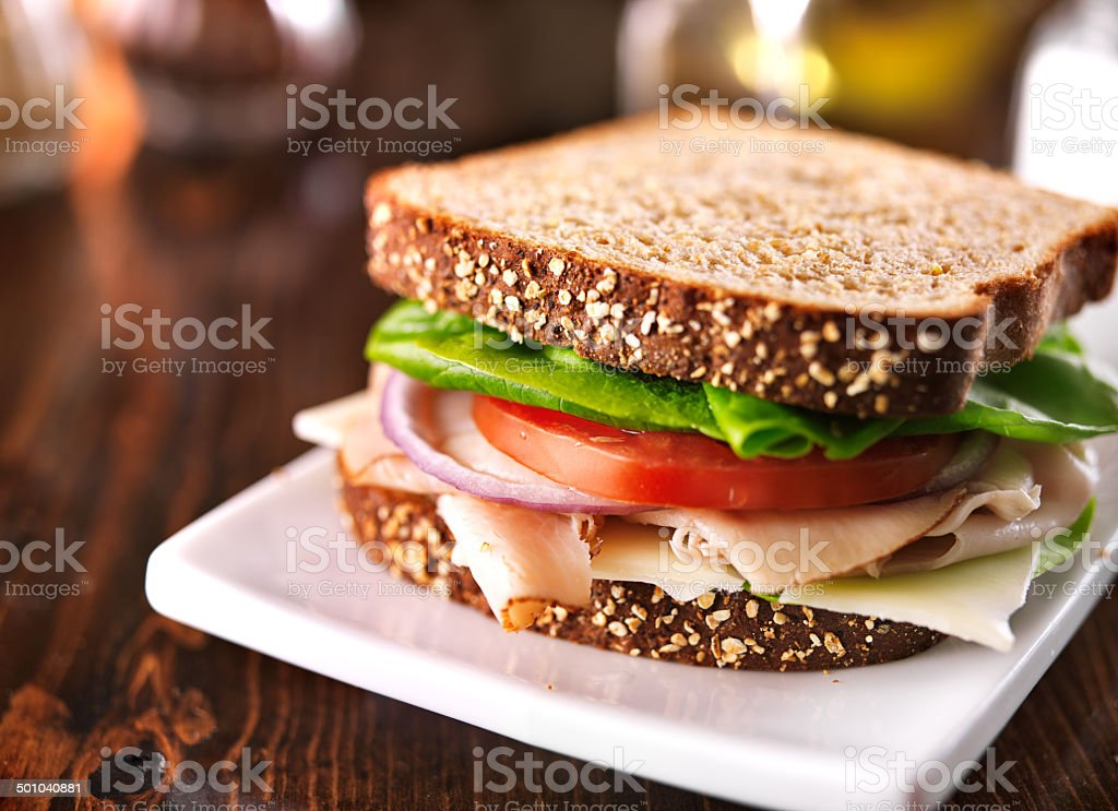 cold cut turkey sandwich on whole wheat with swiss cheese stock photo