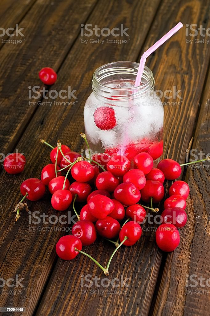 Cold drink in a jar with pink straw stock photo