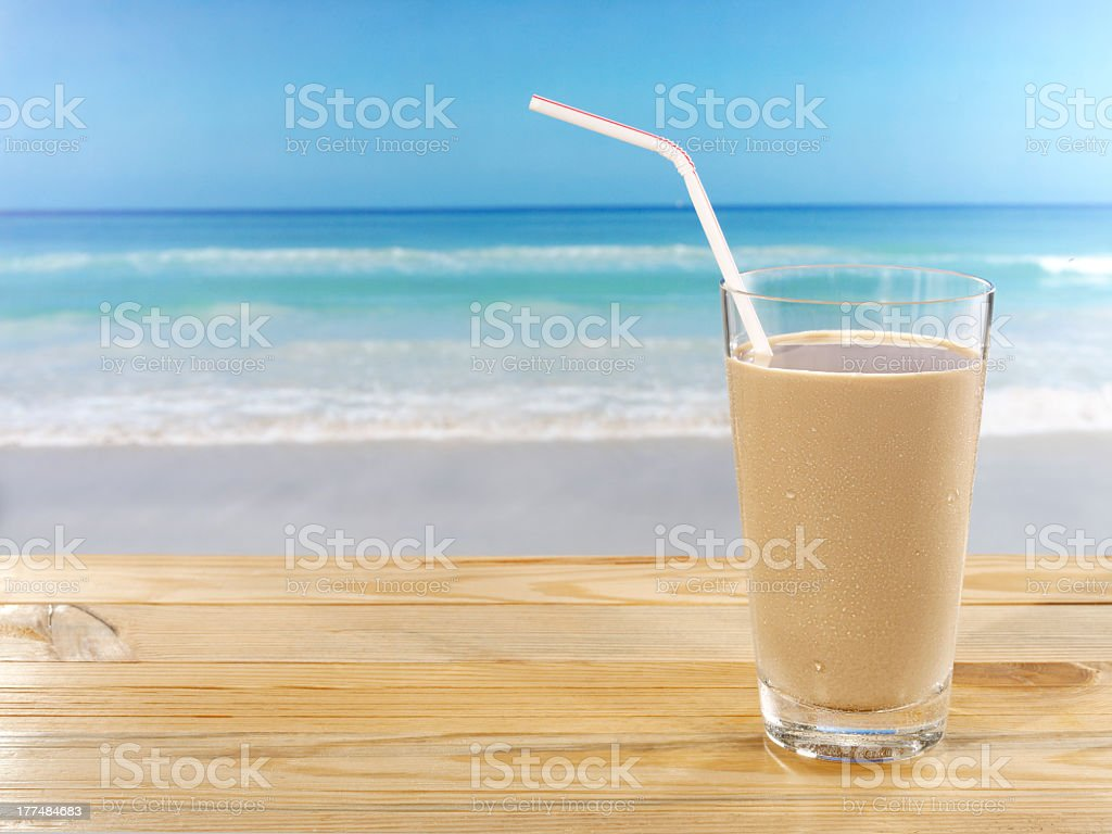 cold drink on beach stock photo