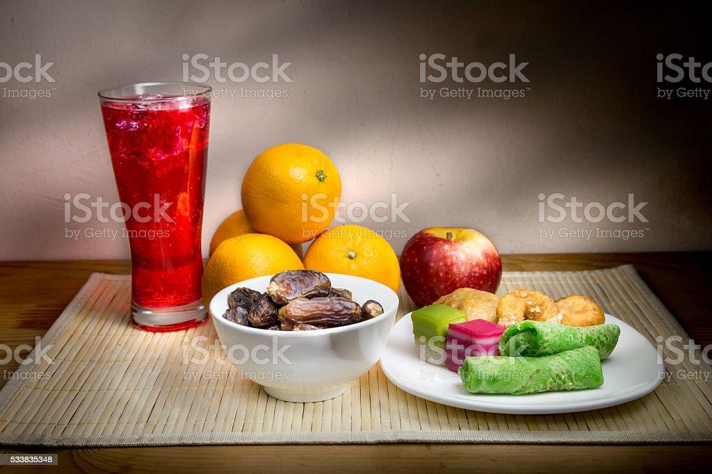 Cold drinks, dates, sweet kuih common iftar break fast food. stock photo
