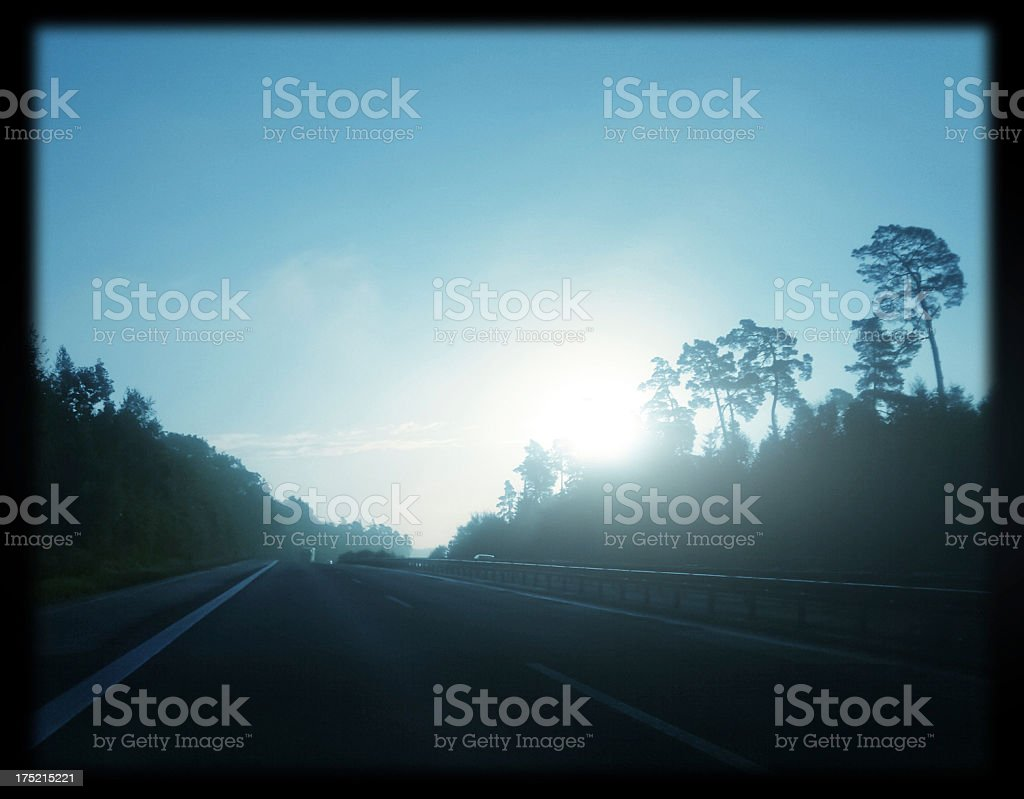 cold foggy morning on highway stock photo