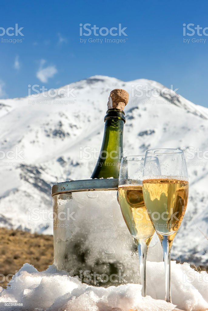 Cold french champagne at Alps stock photo