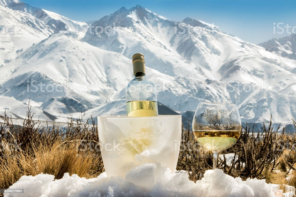 Cold french white wine at Alps stock photo