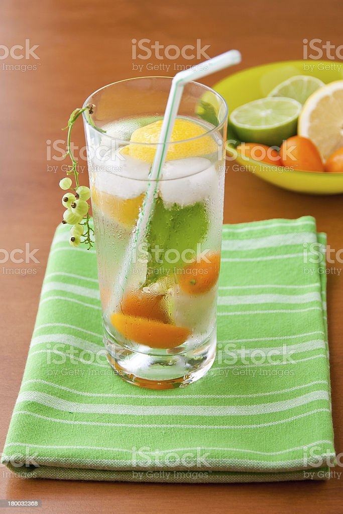 Cold fresh drink with lemon, lime, kumquat and mint. royalty-free stock photo