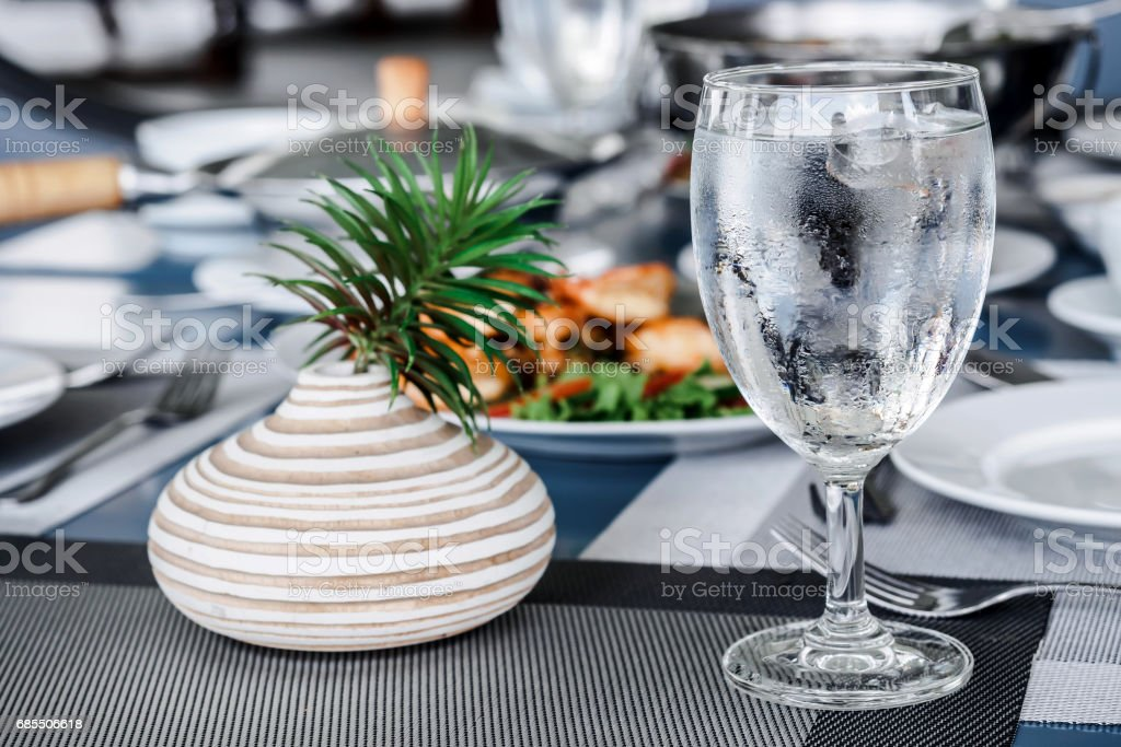 Cold glass on dining table stock photo