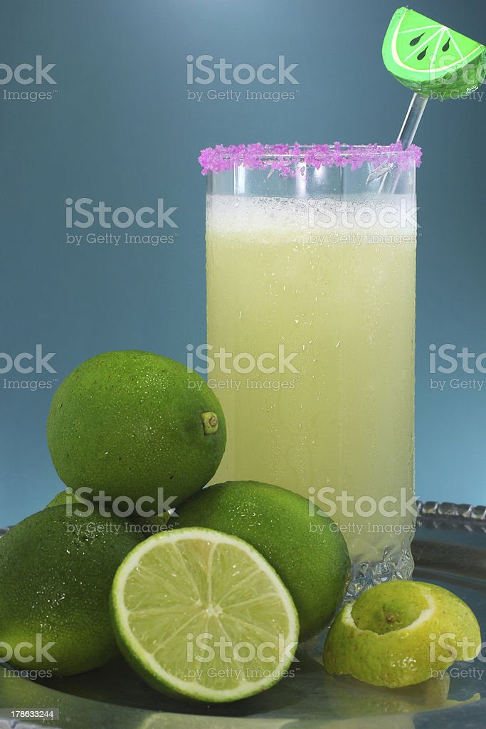 cold lemon juice and fresh lemons royalty-free stock photo
