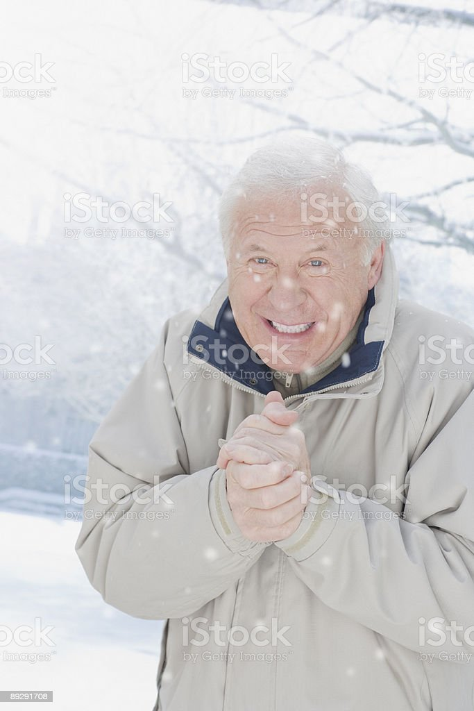 Cold man standing in snow royalty-free stock photo