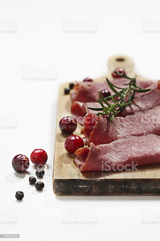 Cold meat with cranberries and rosemary royalty-free stock photo