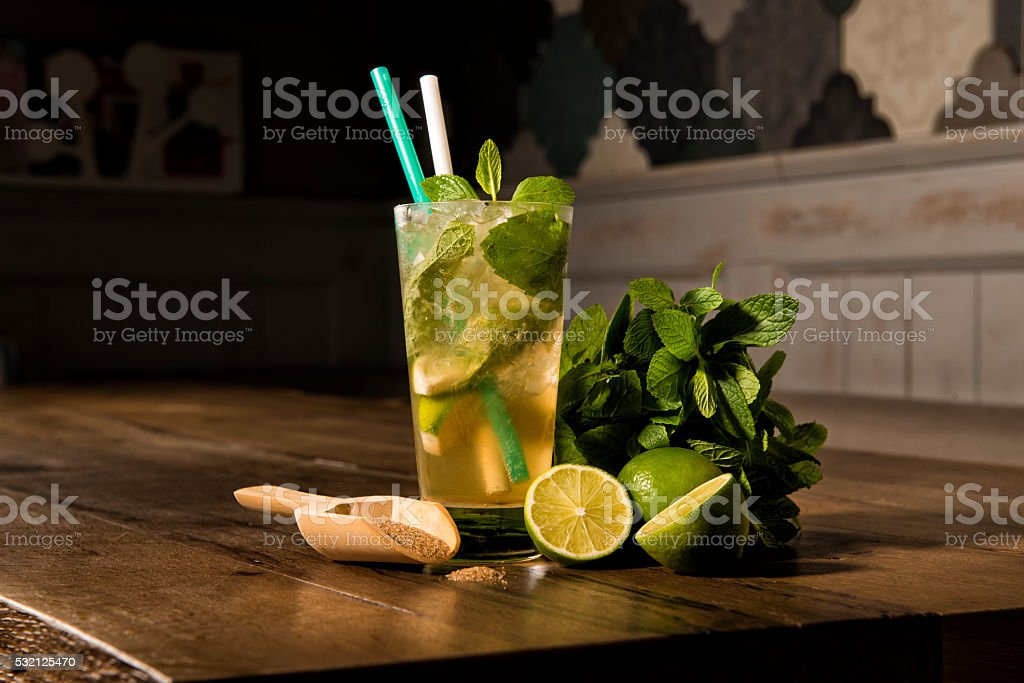 cold mojito cocktail with ingredients stock photo