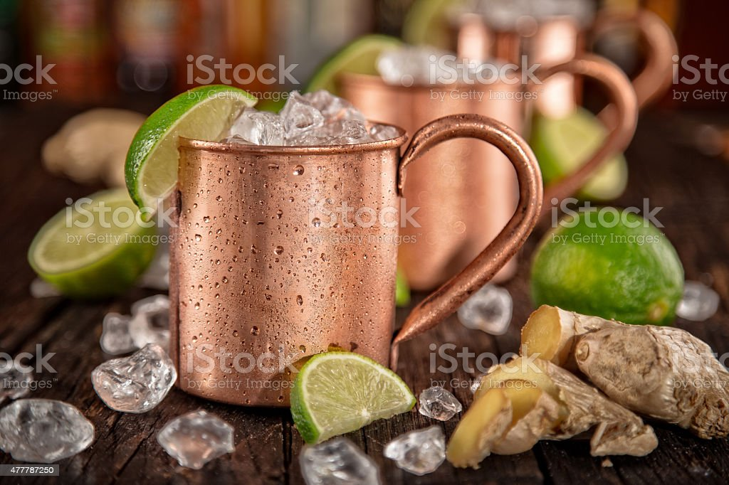 Cold Moscow Mules - Ginger Beer, lime and Vodka stock photo