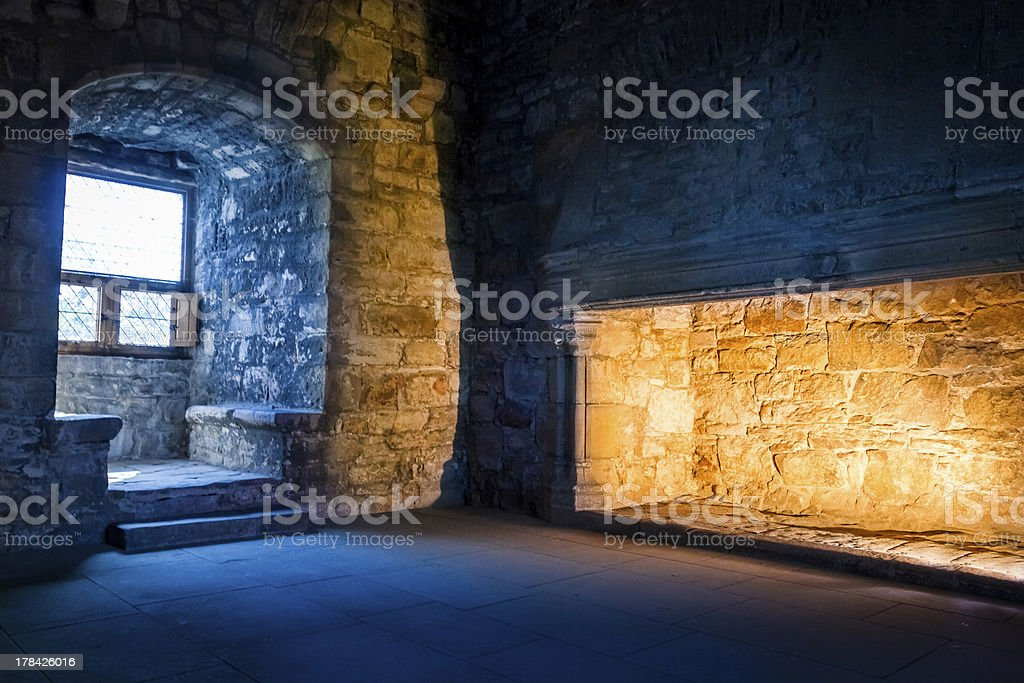 Cold outside and warm inside concept in old castle stock photo