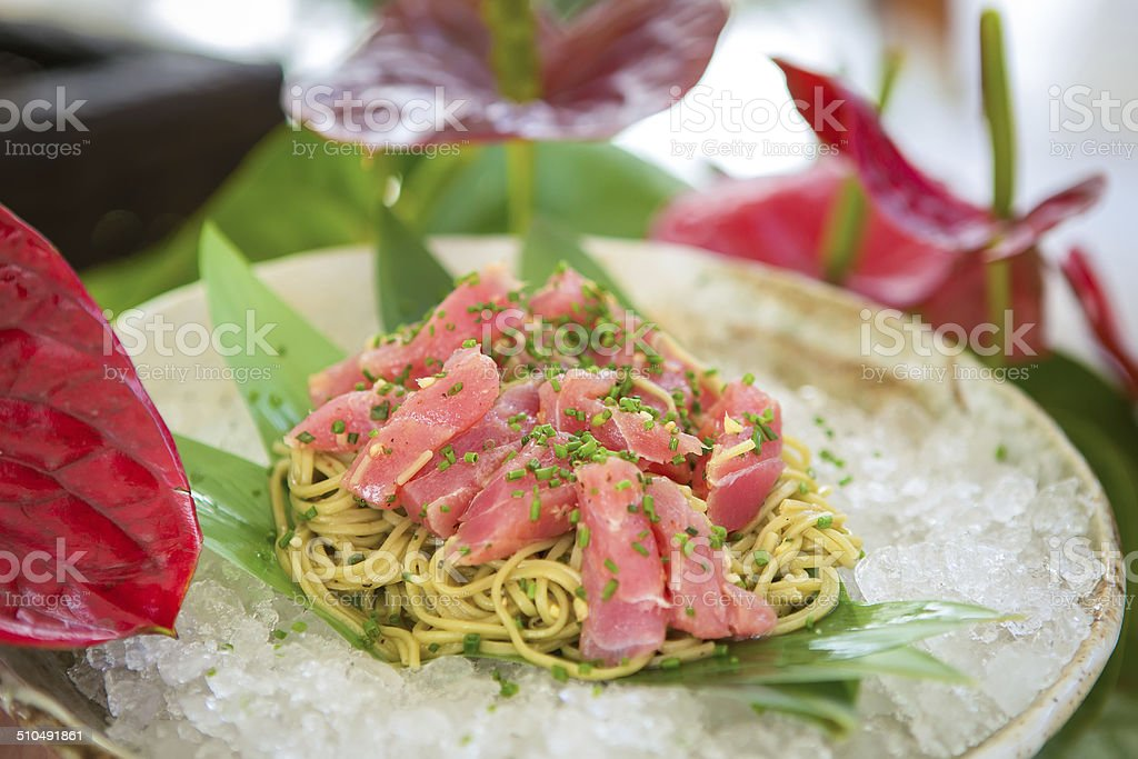 Cold pasta with tuna on ice stock photo