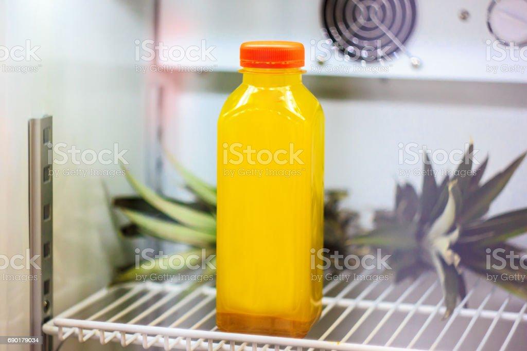 Cold pressed turmeric lemonade in refrigerator stock photo
