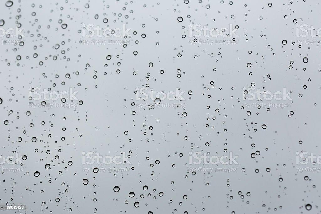Cold rain drops on window stock photo