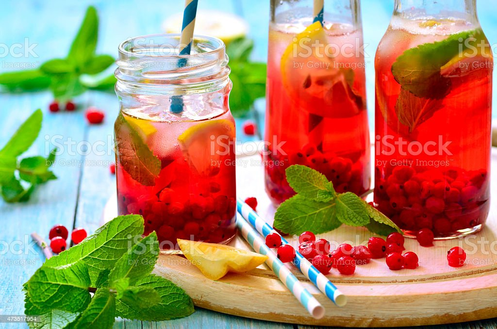 Cold redcurrant tea with lemon and mint. stock photo