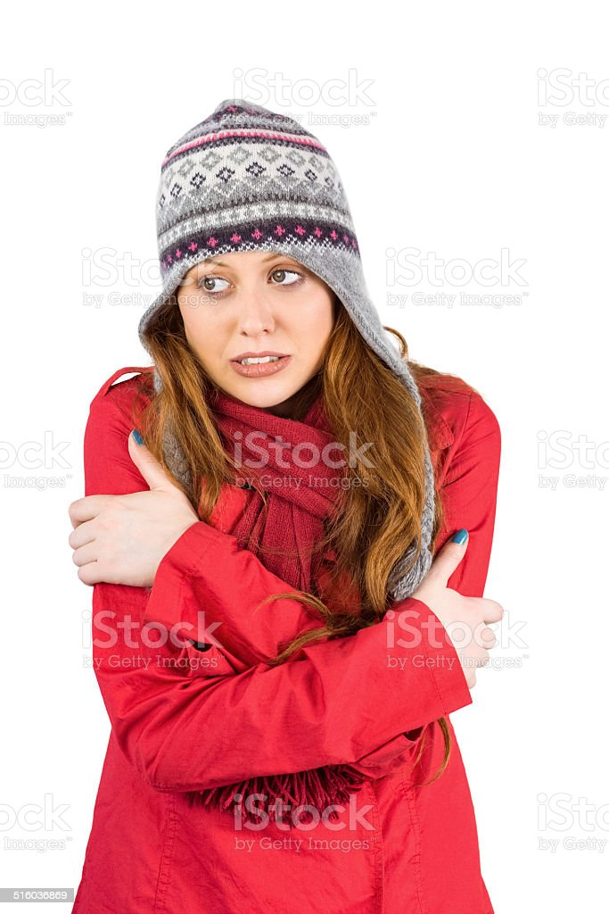 Cold redhead wearing coat and hat stock photo