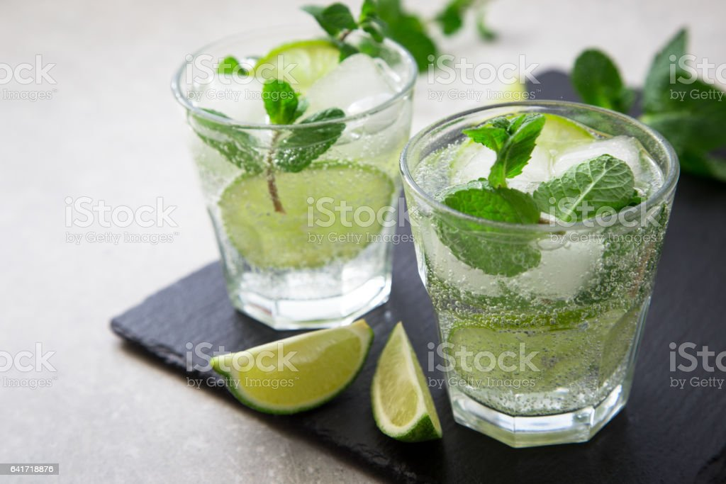 Cold refreshing summer lemonade mojito in a glass stock photo