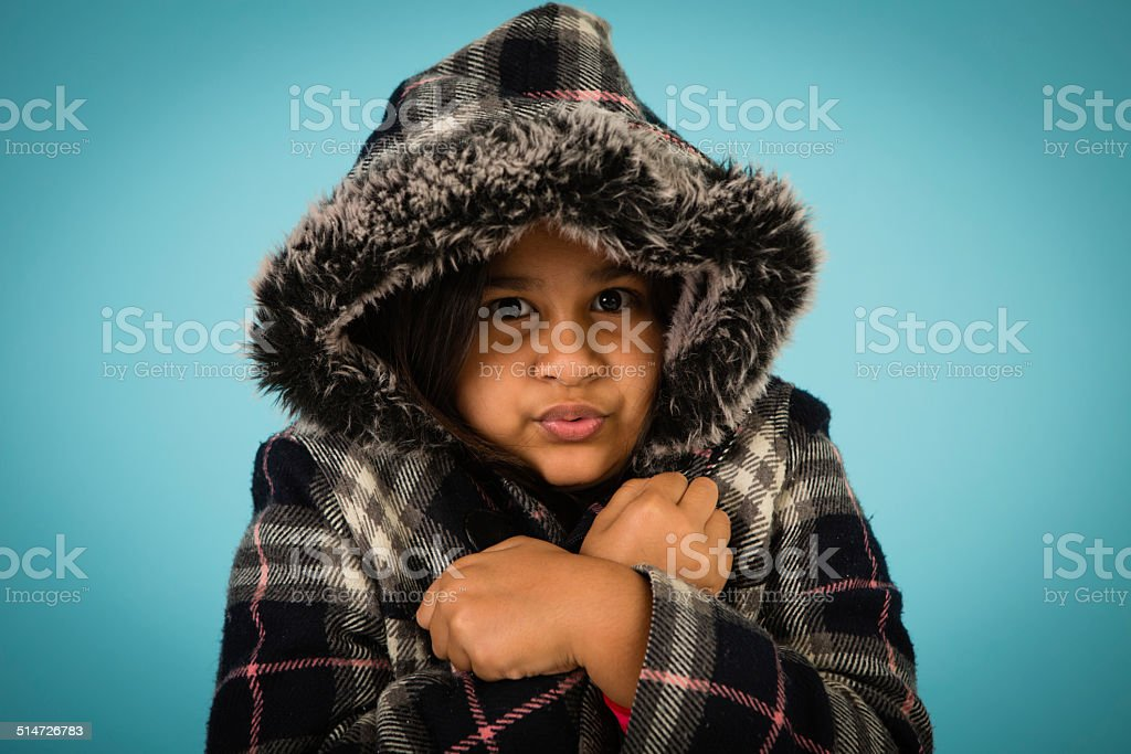 Cold, Sad Little Girl, Trying to Stay Warm stock photo