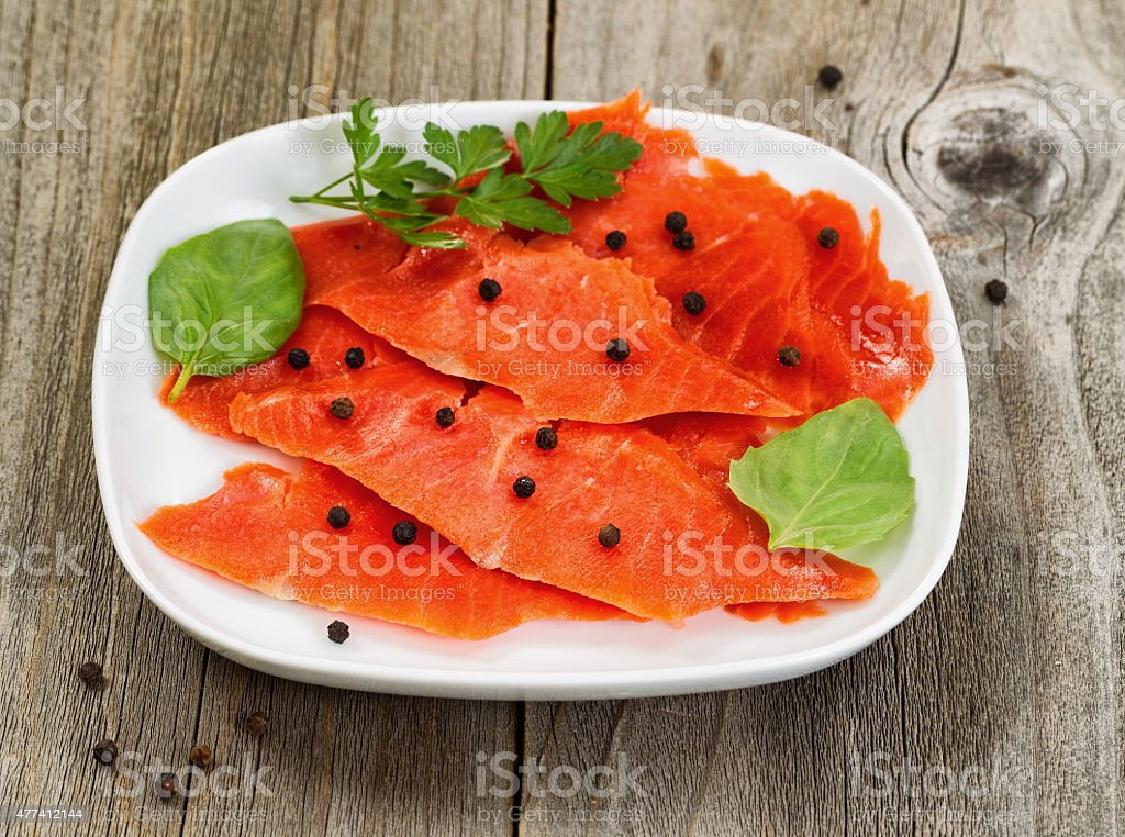 Cold smoked red salmon on plate ready to eat stock photo