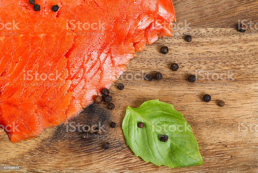 Cold Smoked Red Salmon with spices and herb stock photo