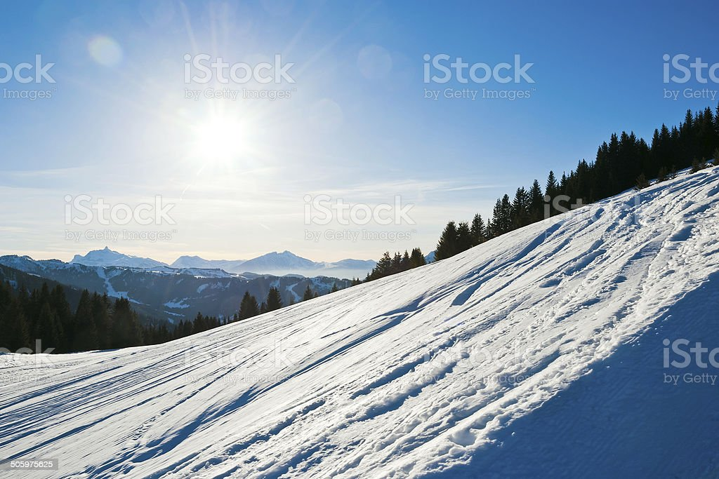 cold snow ski slope on Alps mountain, France stock photo