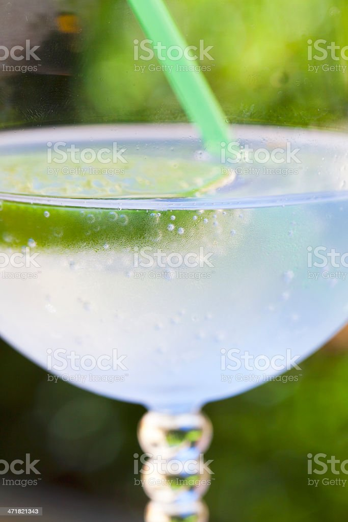 Cold, sparkling, refreshing drink on green royalty-free stock photo