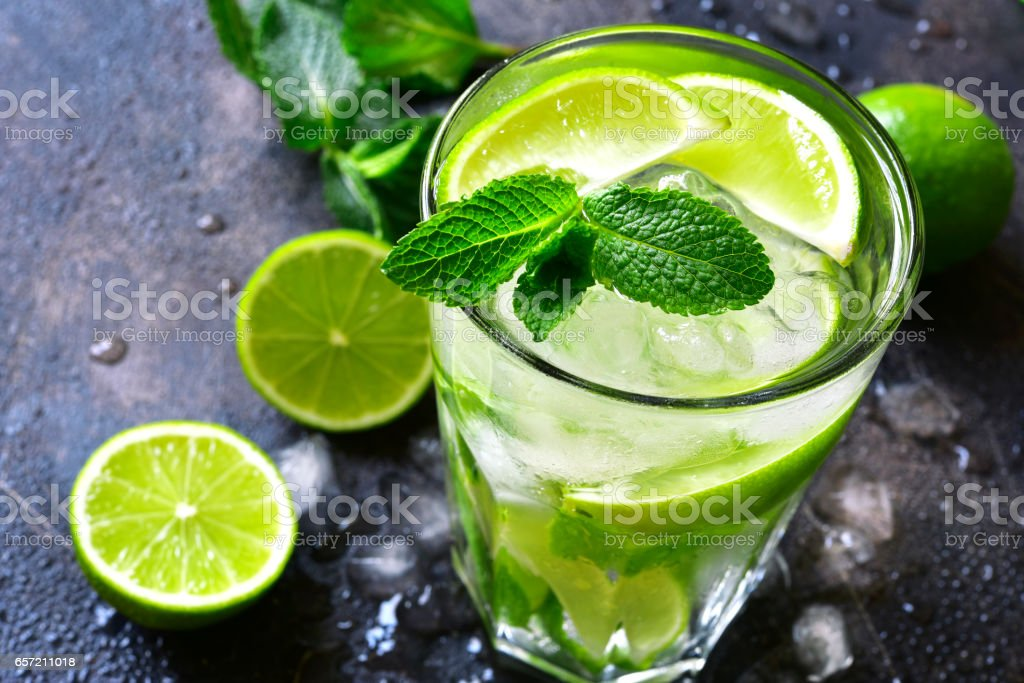 Cold summer drink mojito in a tall glass stock photo