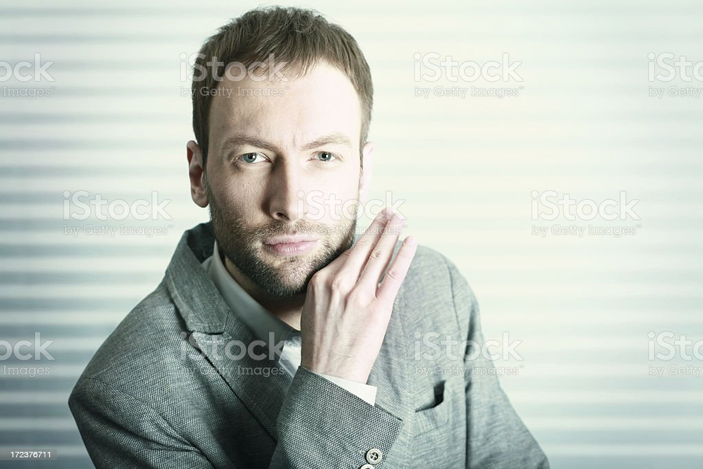 Cold toned fashionable businessman royalty-free stock photo