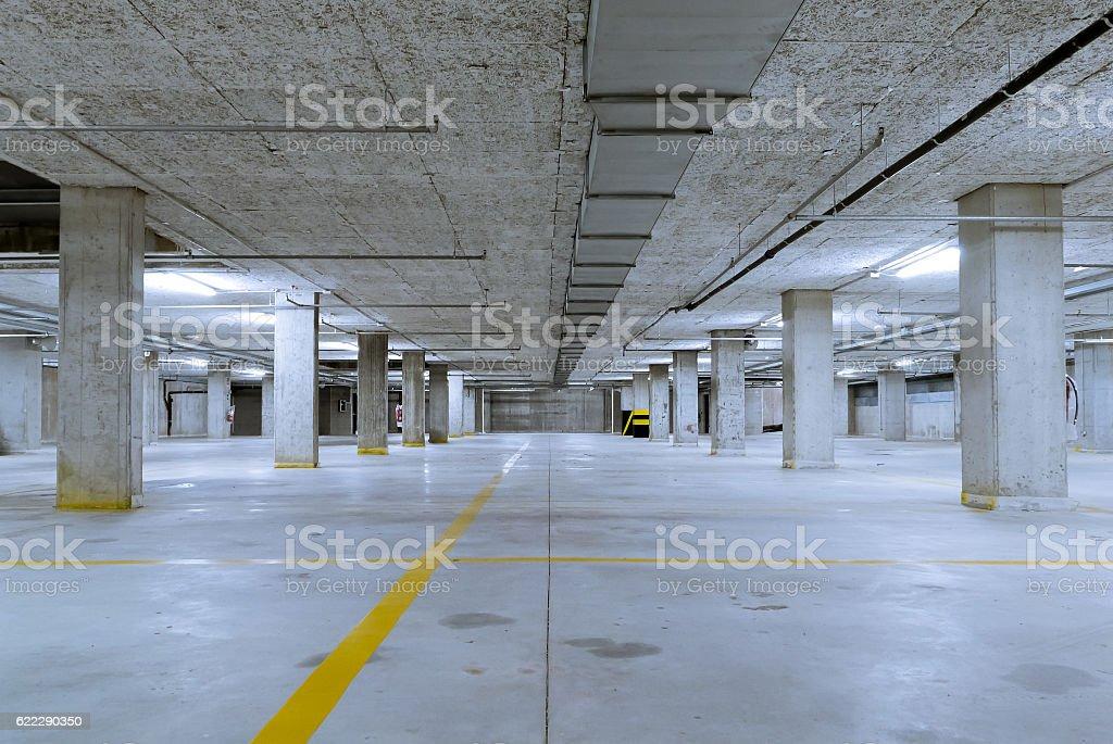 Cold underground car parking garage stock photo