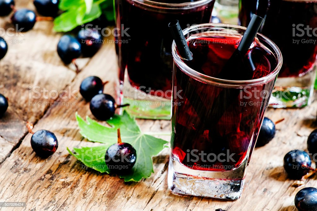 Cold vodka with blackcurrant juice and fresh berries stock photo