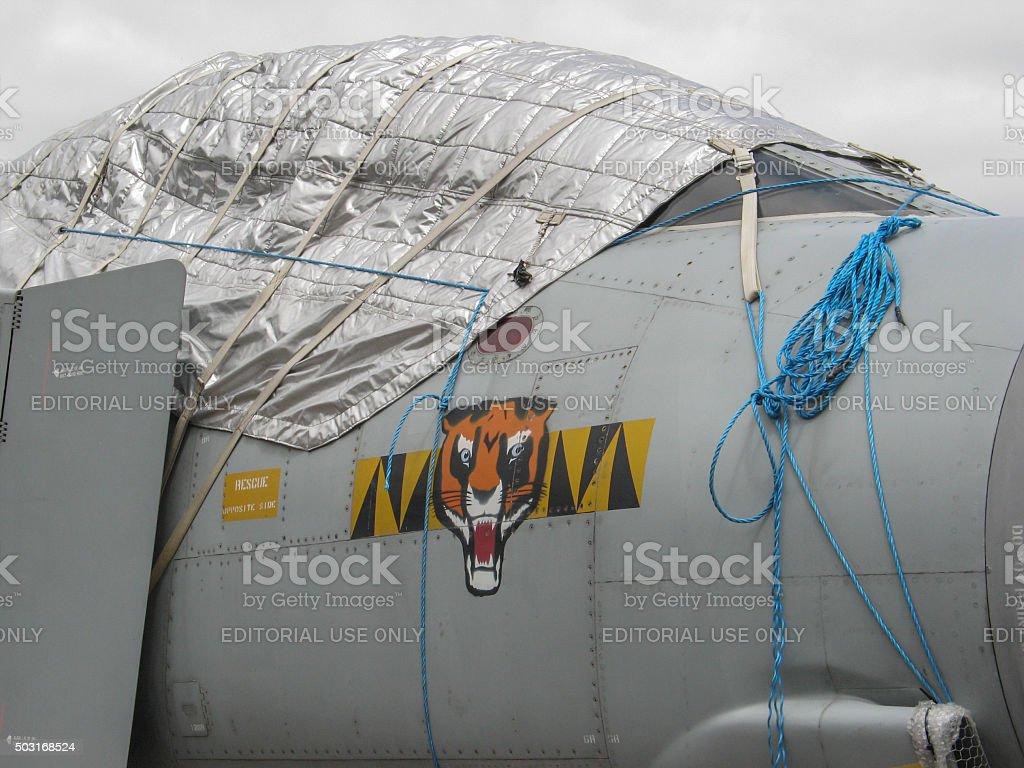 Cold War Era Jet Fighter in storage stock photo