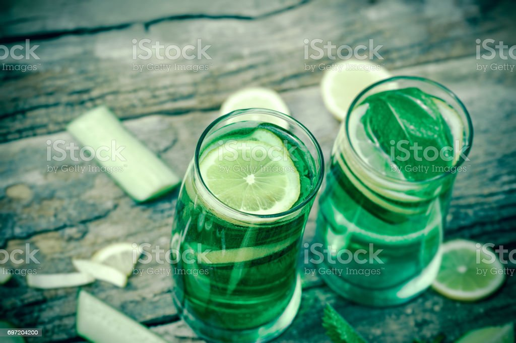 Cold water-mineral water with lemon, mint and vegetable stock photo