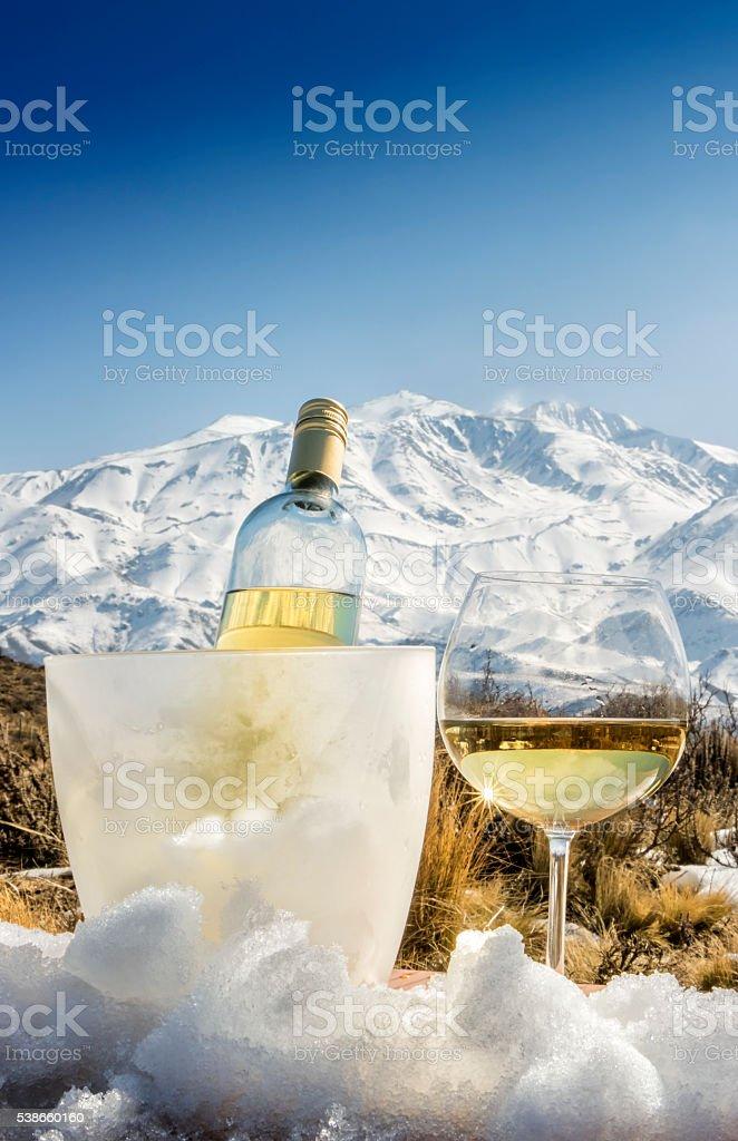 Cold white wine at Alps stock photo