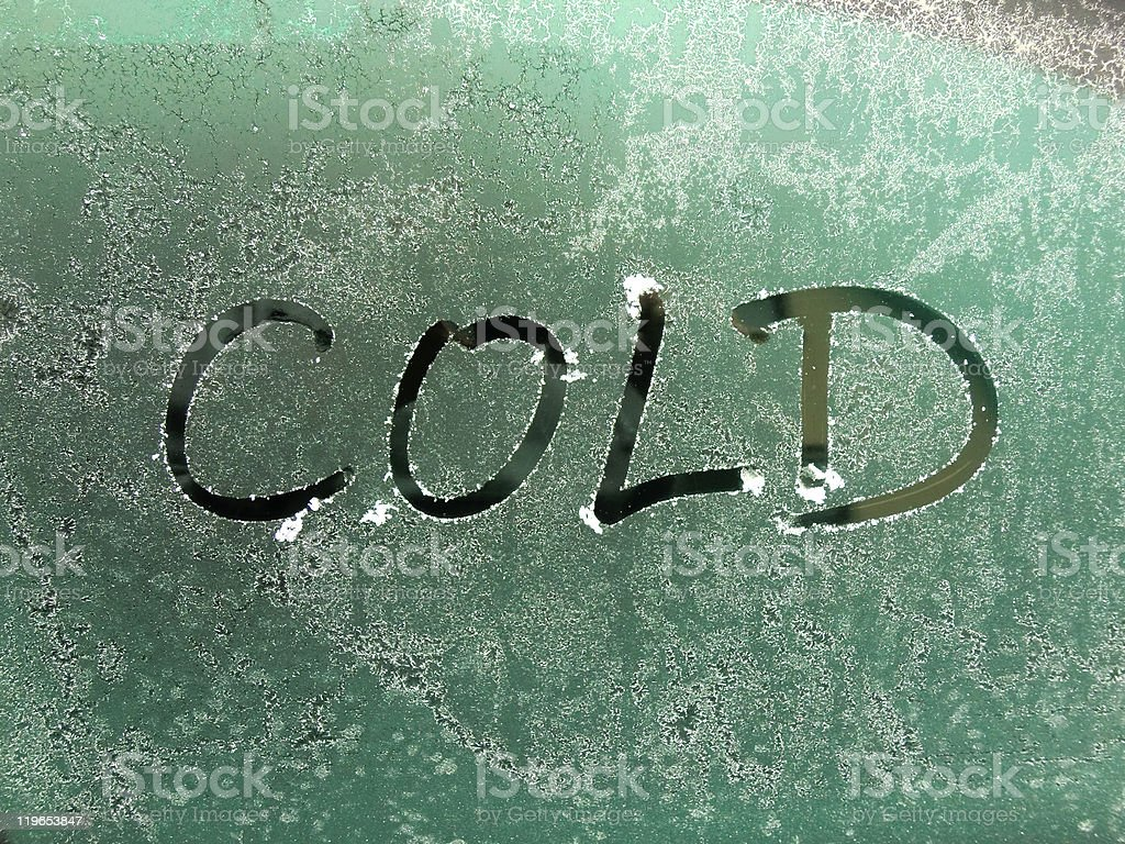 Cold written in the condensation on a window stock photo