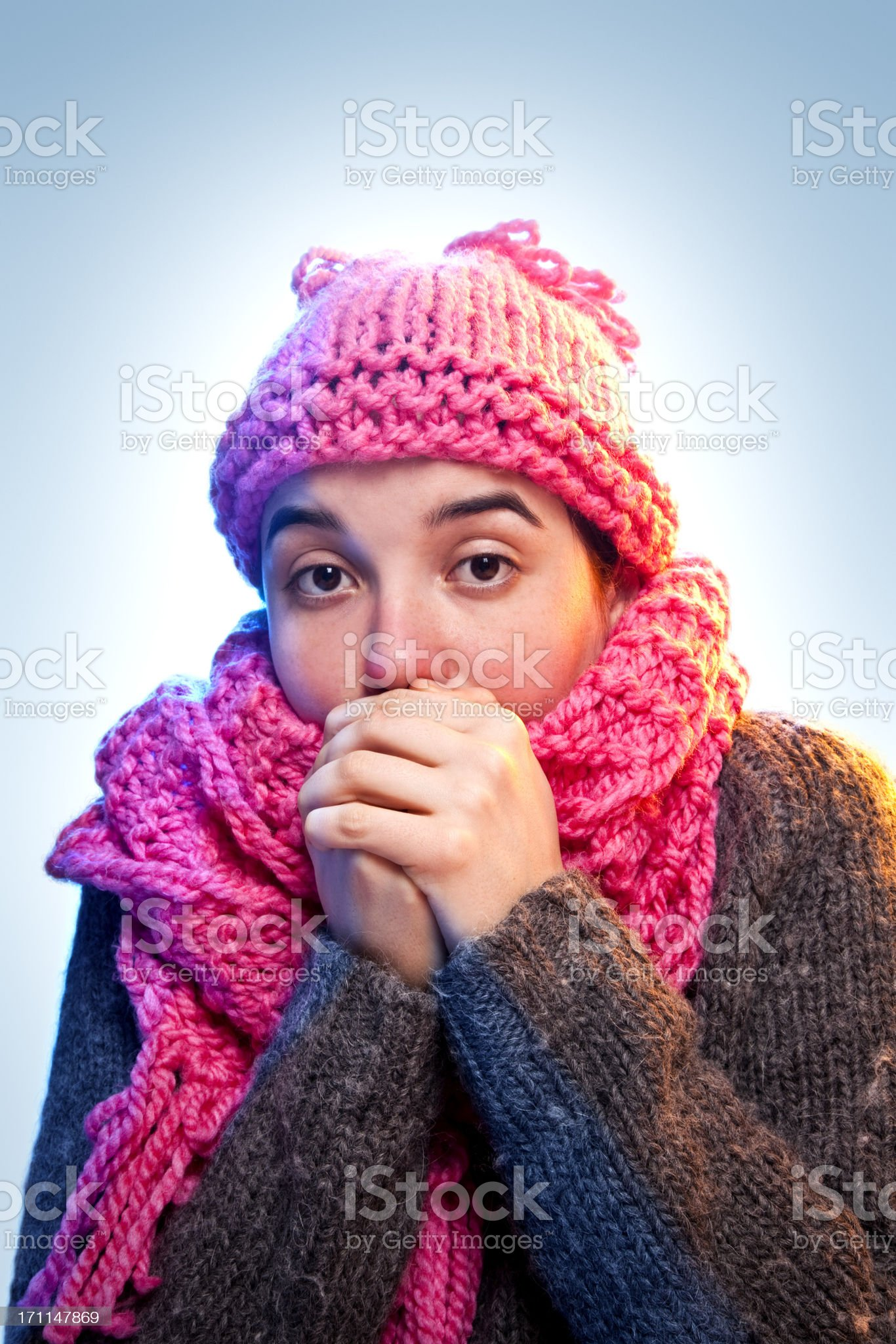 cold young woman holding hands to mouth royalty-free stock photo