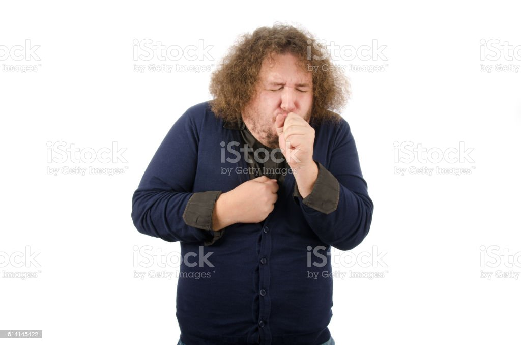 Colds and flu. Man coughs. stock photo