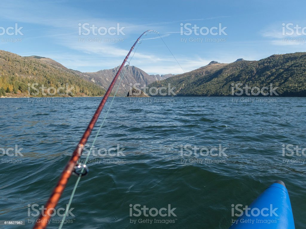 Coldwater Lake Washington State with Fishing Rod from Boat stock photo
