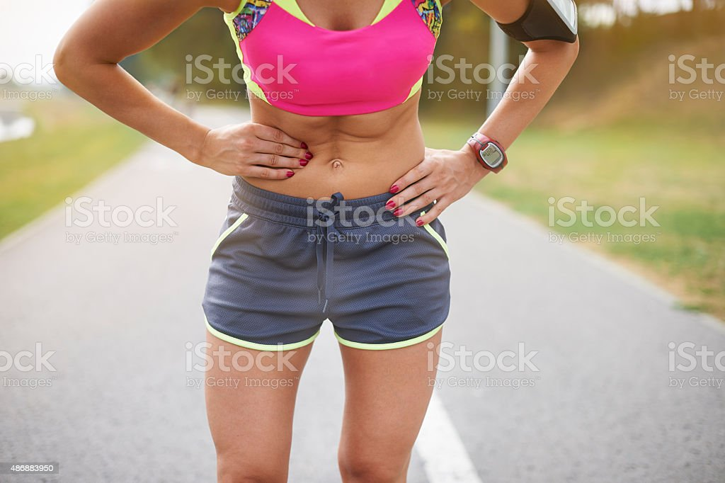 Colic is a frequent problem while jogging stock photo