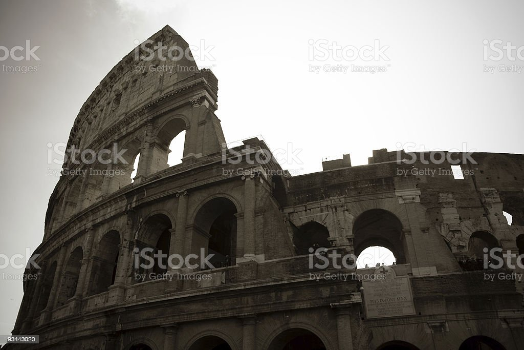Coliseum in Rome, Italy with cloudy sky in sepia royalty-free stock photo