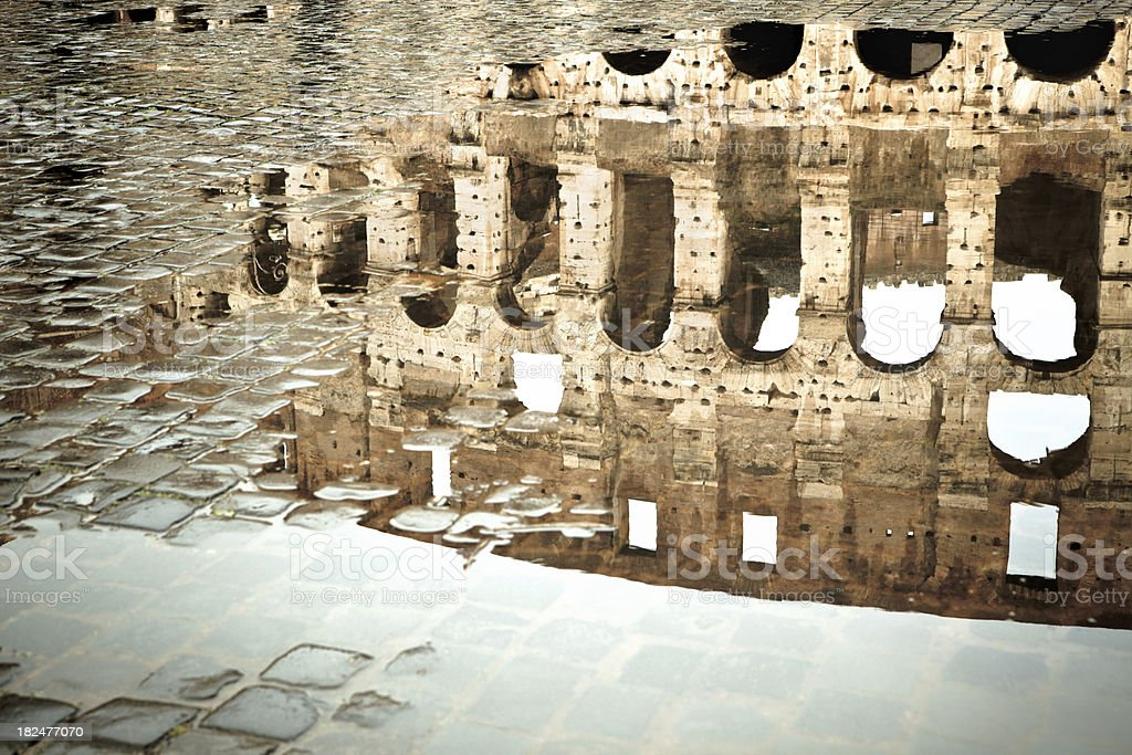 Coliseum reflected in a puddle, Rome Italy royalty-free stock photo
