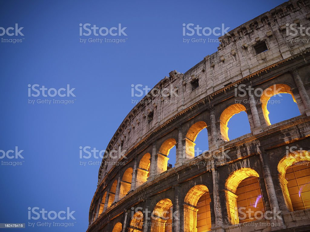 Coliseum with blue sky at dusk royalty-free stock photo