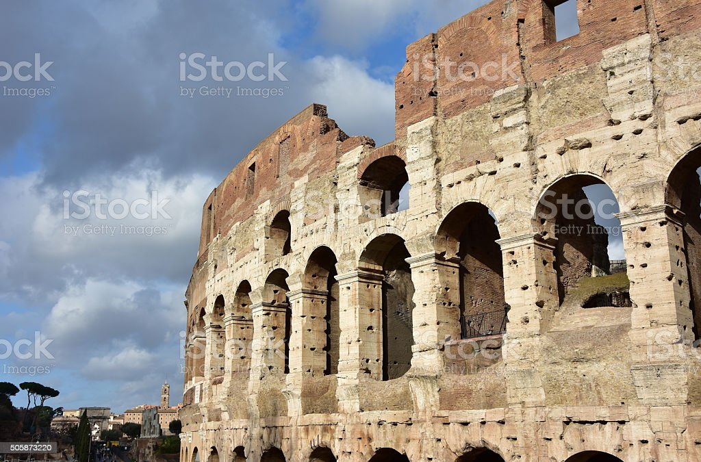 Coliseum with clouds stock photo